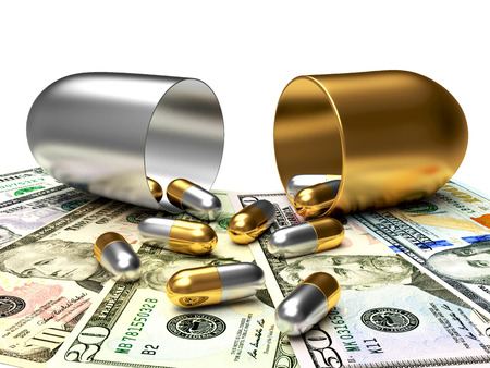 high cost of healthcare: Medical golden and silver capsules spilled out of an open capsule on dollar bills. High costs of expensive medication concept Stock Photo