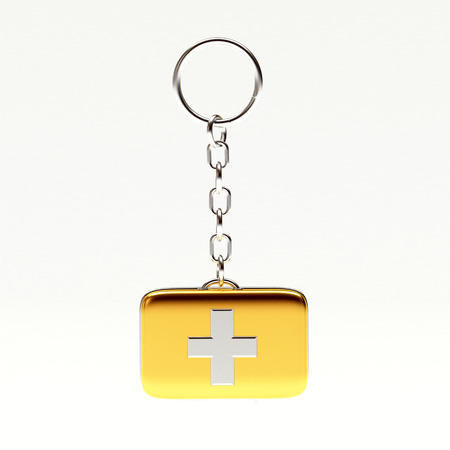first aid kit key: Golden key chain in the form of a medical bag isolated on white background. 3d Rendering Stock Photo