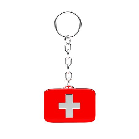 first aid kit key: Key chain in the form of a red medical bag isolated on white background Stock Photo