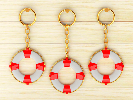 keychains: Keychains in the form of lifebuoys is hanging on the wooden wall. 3d illustration Stock Photo