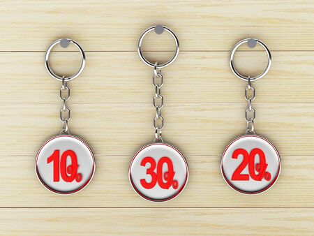 keychains: Set of silver keychains with red 10,20,30 percentages discount on wooden background. 3D illustration Stock Photo