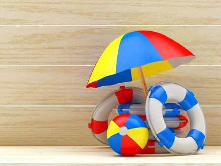 lifebelt: Beach umbrella, ball and pile of lifebuoys on wooden background with space for text. 3D illustration Stock Photo