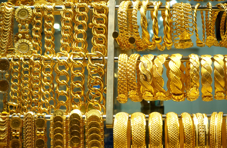 Close-up of gold bracelets and large chains in the jewelry store on the Grand Bazaar. Istanbul, Turkey.