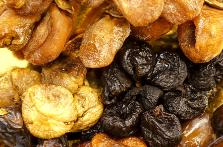 Prunes and figs as a background. Reklamní fotografie