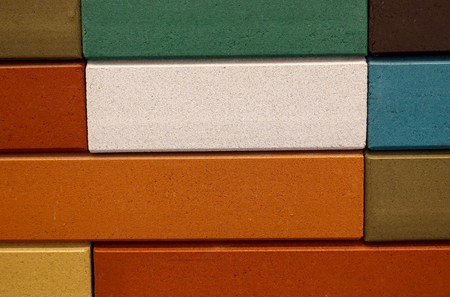 Wall of bright multicolored decorative bricks as a background.