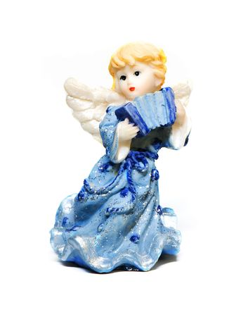 statue of little angel on a light background photo