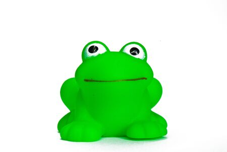 green rubber toy frog for bathing on a white background Stock Photo