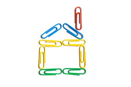 Paper clips in different figures on a white background
