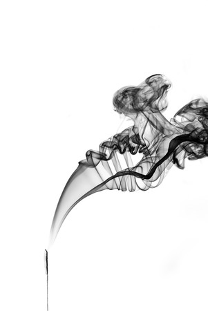 abstract figure from smoke on the isolated background photo
