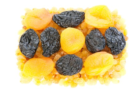 useful: Composition from dried fruits on a light background