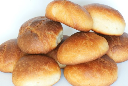 sweetness: Fresh small bread on a light background