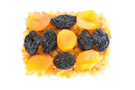 Composition from dried fruits on a light background photo