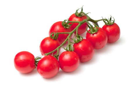 Cluster of cherry  tomatoes on the white isolated background