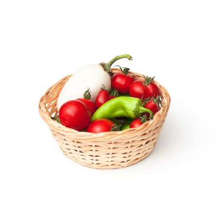 mix of vegetable in a small basket on the white isolated background