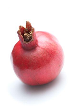 ripe whole pomegranate on the white isolated background Stock Photo