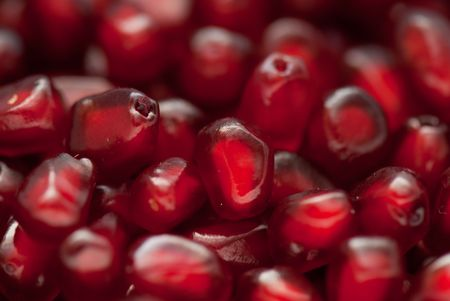 Macro of peeled ripe seeds pomegranate isolated photo