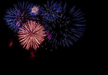 large festive firework on a black background photo
