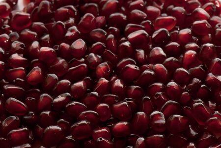 Macro of peeled ripe seeds pomegranate isolated photo