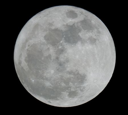 Full moon closeup showing the details of the lunar surface Stock Photo