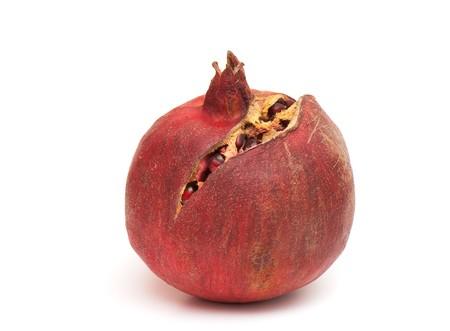 Macro of peeled ripe seeds pomegranate isolated