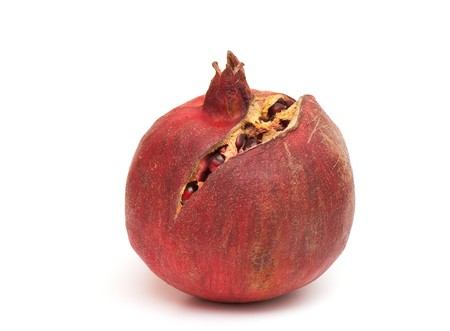 Macro of peeled ripe seeds pomegranate isolated