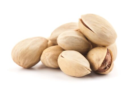 Composition from nuts on the white isolated background Stock Photo