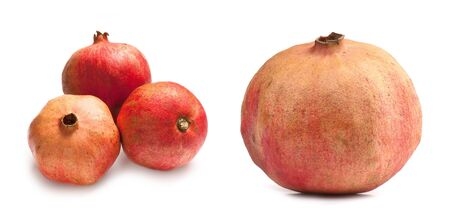 composition of ripe juicy pomegranate  isolated on white background
