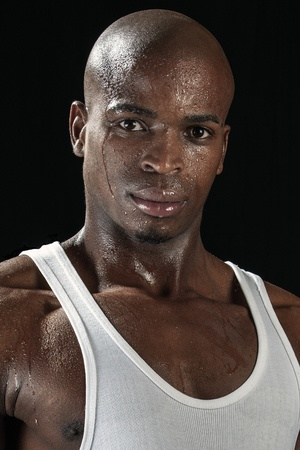 perspiring: Portrait of young handsome African sportsman