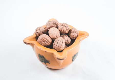 walnuts bowl on white background
