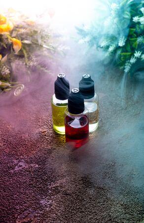 concept vape. Eliquid with fresh background. smoke clouds Liquid bottles