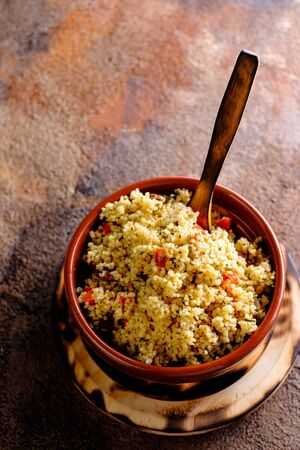 Tabule. Arabian vegetarian salad with couscous. Wooden background. Isolated Фото со стока