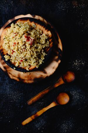 Tabule. Arabian vegetarian salad with couscous. Dark background. Isolated