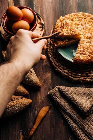 spanish potato omelet called tortilla de patata. Wooden background. Homemade