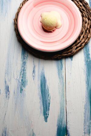 Vanilla ice cream on blue background