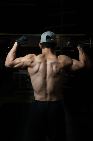 ripped: A ripped back from a calisthenic guy Stock Photo
