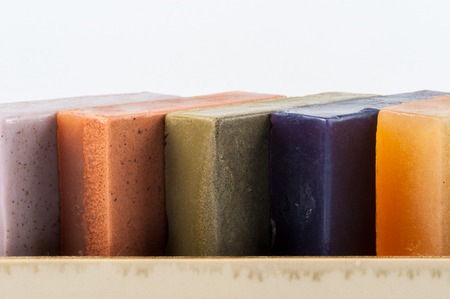 soap: A group of herb soaps on a white background