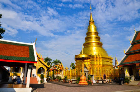 Golden pagoda and backdrop with blue sky at Wat Phra That Hariphunchai , Lamphun Province, of Thailand Stock Photo - 17036440