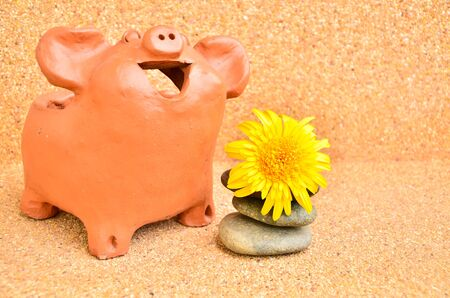 One Pig statues laugh near flower . photo