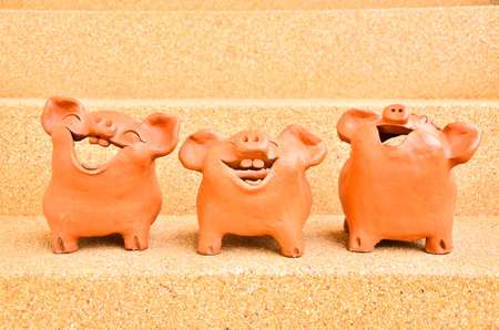 Three Pig statues laugh photo