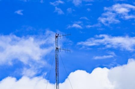 antenna on blue cloud sky