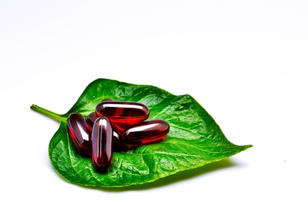 vitamins on green leaf Stock Photo