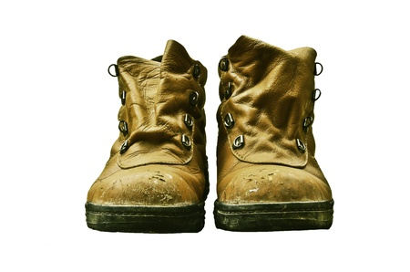 Dirty old boots on white background photo