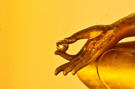 buddha statue hands on yellow background Zdjęcie Seryjne