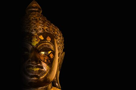 chaplain: buddha head on black background