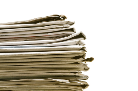 Pile of newspapers on white background photo