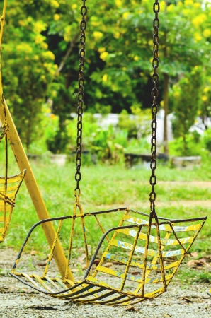 winter escape: Old swings on playground