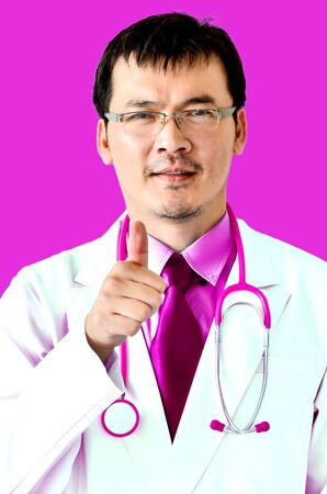 doctor thumbs up on pink light photo
