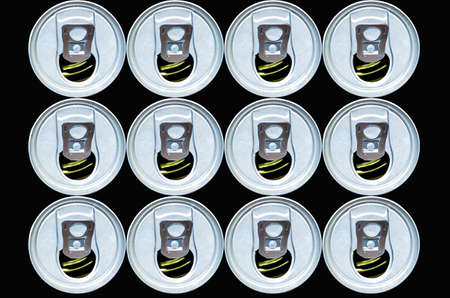 Stacked open cans on black background photo