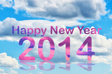 White clouds over the blue sky with happy new year 2014 letters photo