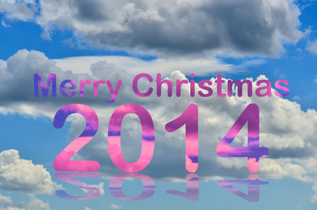 White clouds over the blue sky with merry christmas 2014 letters photo